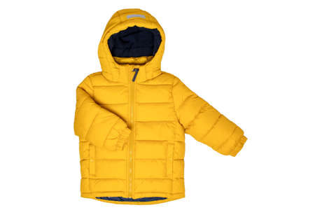 Down jacket for children. Stylish, yellow, warm winter jacket for children with removable hood, isolated on a white background. Winter fashion.