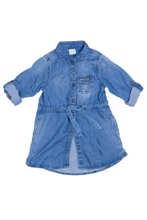 Denim dress isolated. Close-up of cute long sleeves blue jean dress for little child girl isolated on a white background. Denim fashion for kids.