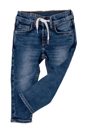 Jeans isolated. Trendy stylish blue denim pants or trousers with white ribbon for child boy isolated on a white background. Jeans summer and autumn fashion. Front view.