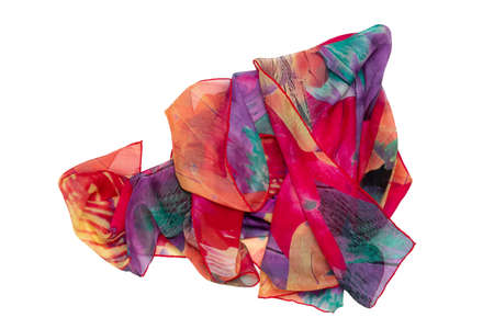 Silk neckerchief isolated. Closeup of a beautifully wrapped multicolored silk scarf or headscarf with a pattern isolated on a white background. Top view, flat lay, copy space.