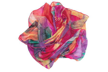 Silk shawl isolated. Close-up of a beautifully folded multicolored silk scarf or headscarf isolated on a white background. Top view, flat lay, copy space. Banque d'images