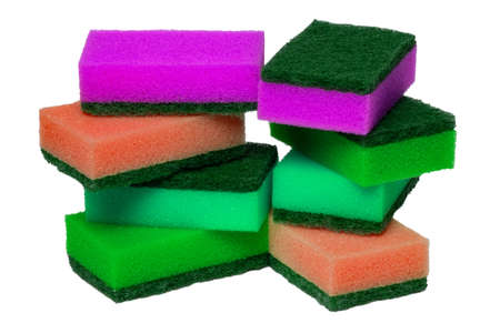 Closeup of a stack or heap of various colorful sponges or scouring pads isolated on a white background. Household chore concept. Top view. Macro.