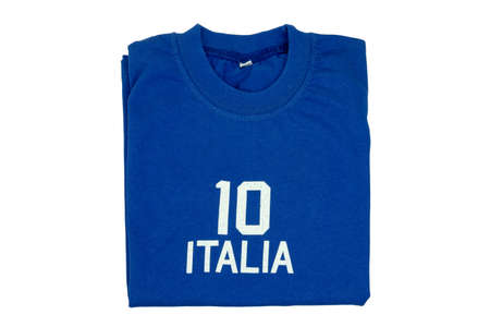 Blue t-shirt for kids. Folded soccer or polo shirt with the inscription italia and the number ten isolated on white background. Summer fashion kids.