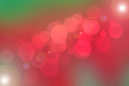 A festive abstract gradient orange pink red and green background texture with glitter defocused sparkle bokeh circles and stars. Card concept for Happy New Year, party invitation, valentine or other holidays. 免版税图像