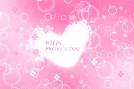 Mothers day greeting card. Abstract festive pink bokeh background texture with a Happy mothers day text on a large white heart. Beautiful illustration of concept of love.