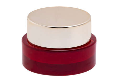 Closeup of an cosmetic jar of rose concealer cream, makeup foundation, moisturizing cream for the face or an other beauty or make-up product isolated on a white background. Space for label. 免版税图像