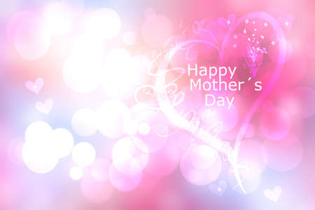 Mothers day greeting card. Abstract festive pink bokeh background texture with a Happy mothers day text on a large heart. Beautiful illustration of concept of love.