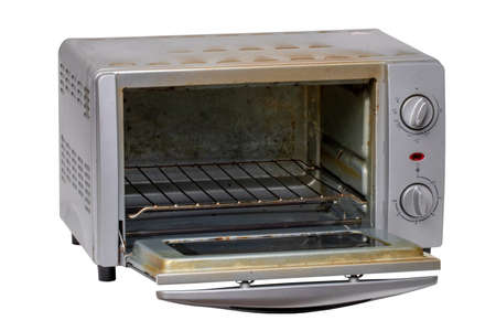 Household kitchen appliances. Close-up of a old small opened electric oven isolated on a white background. Macro. 免版税图像