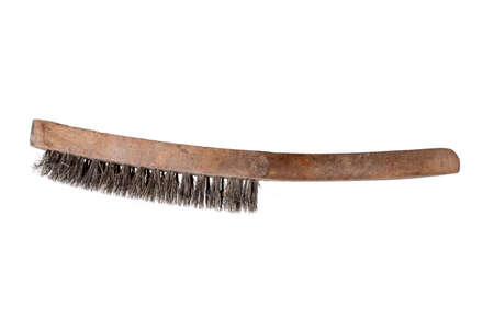 Close-up of a steel wire brush with wooden handle isolated on a white background. Used for cleaning metal surfaces and cleaning barbecue grill. Macro. 免版税图像