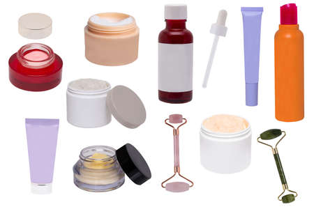 Collage of make up cosmetics and tools. Set of various open jars or bottles with cream for face, liquid make-up pillow, skin care products, serum for face, jade facial roller and other beauty accessories isolated on a white background.
