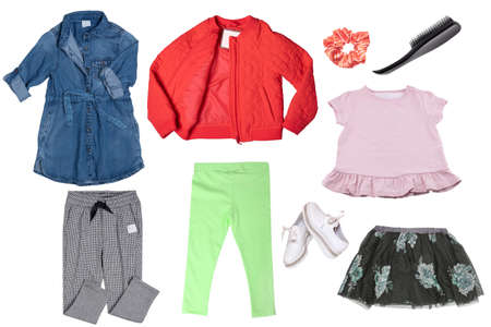 Collage set of little girl clothes isolated on a white background. The collection of a denim dress, a rain jacket, pants, shoes, a short skirt, a pink shirt and other accessories. Fashionable girls outfit. 免版税图像