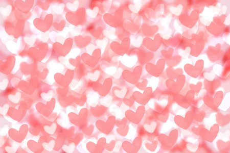 Abstract festive blur bright pink pastel background texture with pink and white hearts love bokeh for Mothers day, valentine or wedding card. Space for design. Card concept. 免版税图像