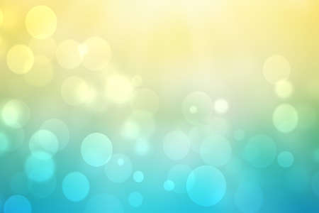 Abstract gradient of light blue yellow pastel background texture with glowing circular bokeh lights. Beautiful colorful spring or summer backdrop.