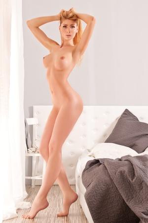 Beautiful, naked woman stretching Stock Photo