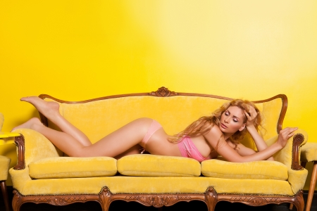 Beautiful woman in yellow interior Stock Photo