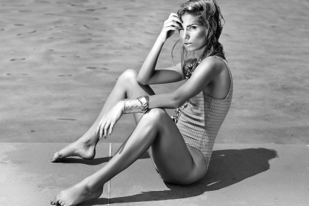 Young beautiful woman posing on the beach