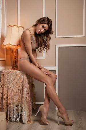 Sexy girl  on a stylish background