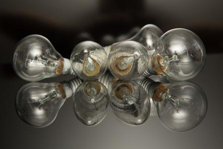 lumen: a lot of light bulb on black background,