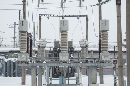 isolator insulator: High voltage electric power substation in winter day