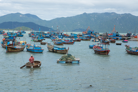 old Vietnamese boat Thung Chai in the sea among the ships