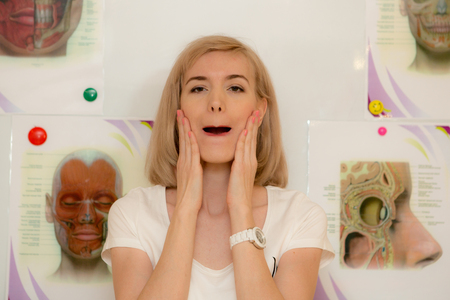 facial gymnastics. the girl does massage and rejuvenating exercises for the face 스톡 콘텐츠