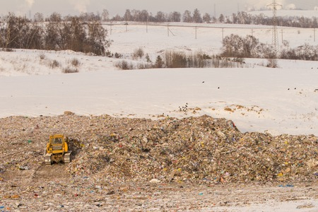 Dump truck at the dump in winter in the snow Stock Photo
