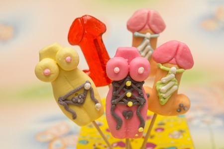 Sex toys, sweet candy, colorful candy on a stick Banco de Imagens