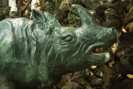 the old concrete statue of a rhinoceros