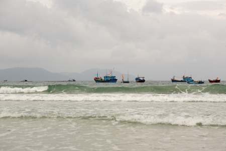 ships at sea, a small wave on a cloudy day in Vietnam Stock Photo