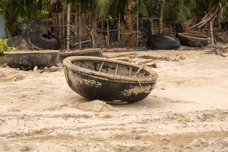 Vietnamese basket Boat Thung Chai in the sand on the seashore Stock Photo