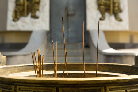 Incense sticks. Worship Buddha image.at Anolayo Thippayaram Temple.THAILAND Stock Photo