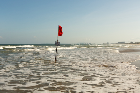 Red warning flag on the beach of Vietnam Cam Ranh