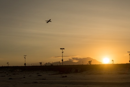Silhouette of a plane taking off from the airport at sunset airport Stock fotó