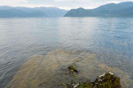 Lake Teletskoye with calm water on a summer day 版權商用圖片