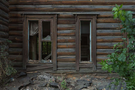 window of an old wooden house dust on the glass.