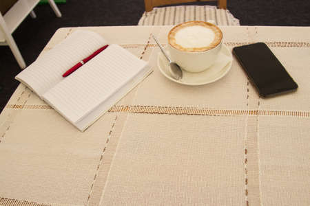 no concept. blank page, cup of coffee, pencil.