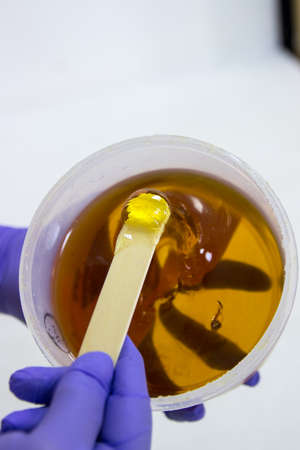 Can on liquid sugar for skin epilation