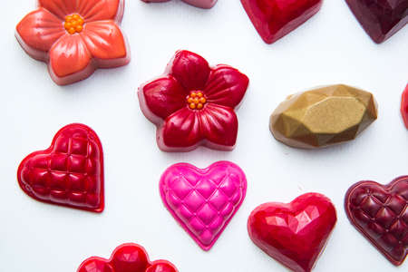 Delicious chocolate candies, close up, different colors.