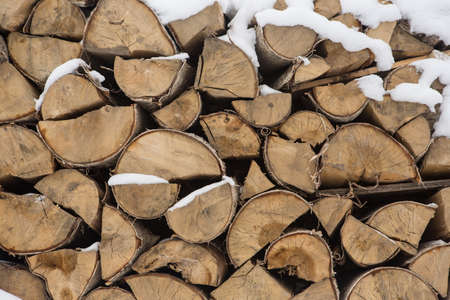 A pile of birch wood. prepared for the winter for kindling the village stove.