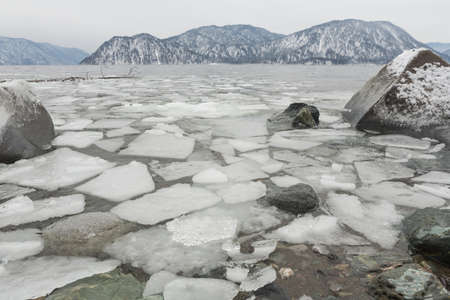 unfrozen Lake Teletskoye in winter. Russia Altai Krai.