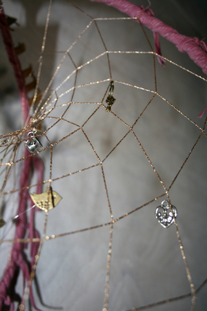 Closeup of a 3-D dreamcatcher with pendants
