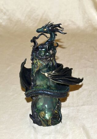 Black, green and gold dragon