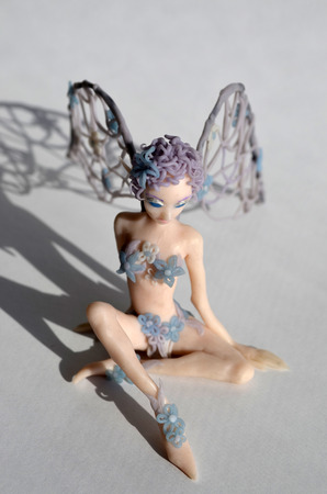 Figurine of a little winged fairy girl, front view