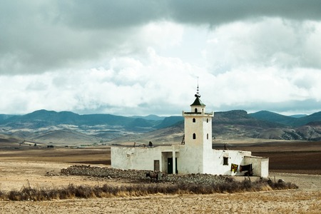 Local mosque near Mrirt on the background of Middle Atlas mountains, Khenifra province, Morocco Stock Photo