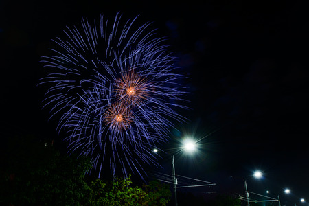 Gold and blue fireworks in sky at the city Stock Photo