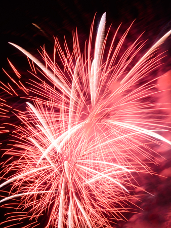 Red fireworks in sky at the city Stock Photo