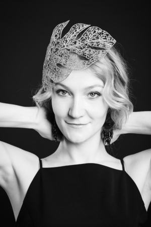 Classic close-up portrait of blonde woman with leaf head accessory, black and white shot