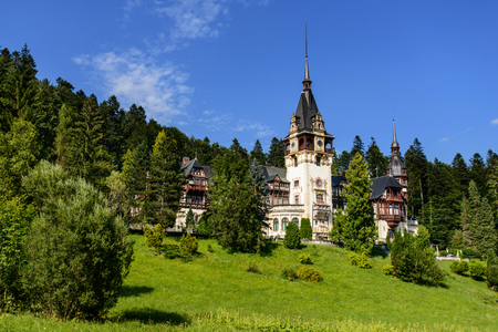 SINAIA, ROMANIA - AUGUST 20, 2014: Faraway view on beautiful Neo-Renaissance Peles palace castle in Carpathian mountains, built between 1873 and 1914 for King Carol I.