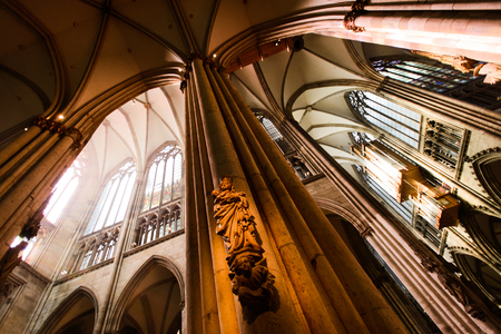 COLOGNE, GERMANY - SEP 23, 2016: Arches and statues at Catholic Cologne Cathedral, being built since 1248