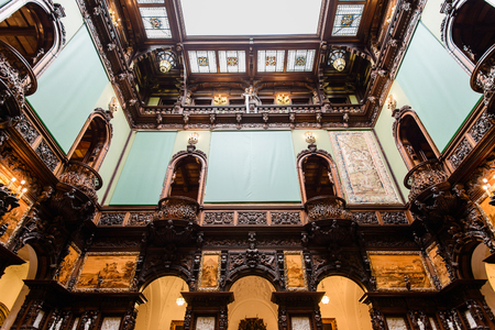 SINAIA, ROMANIA - AUGUST 20, 2014: The interior of Neo-Renaissance Peles palace castle in Carpathian mountains, built between 1873 and 1914 for King Carol I. The Entrance Hall of Honour Editöryel